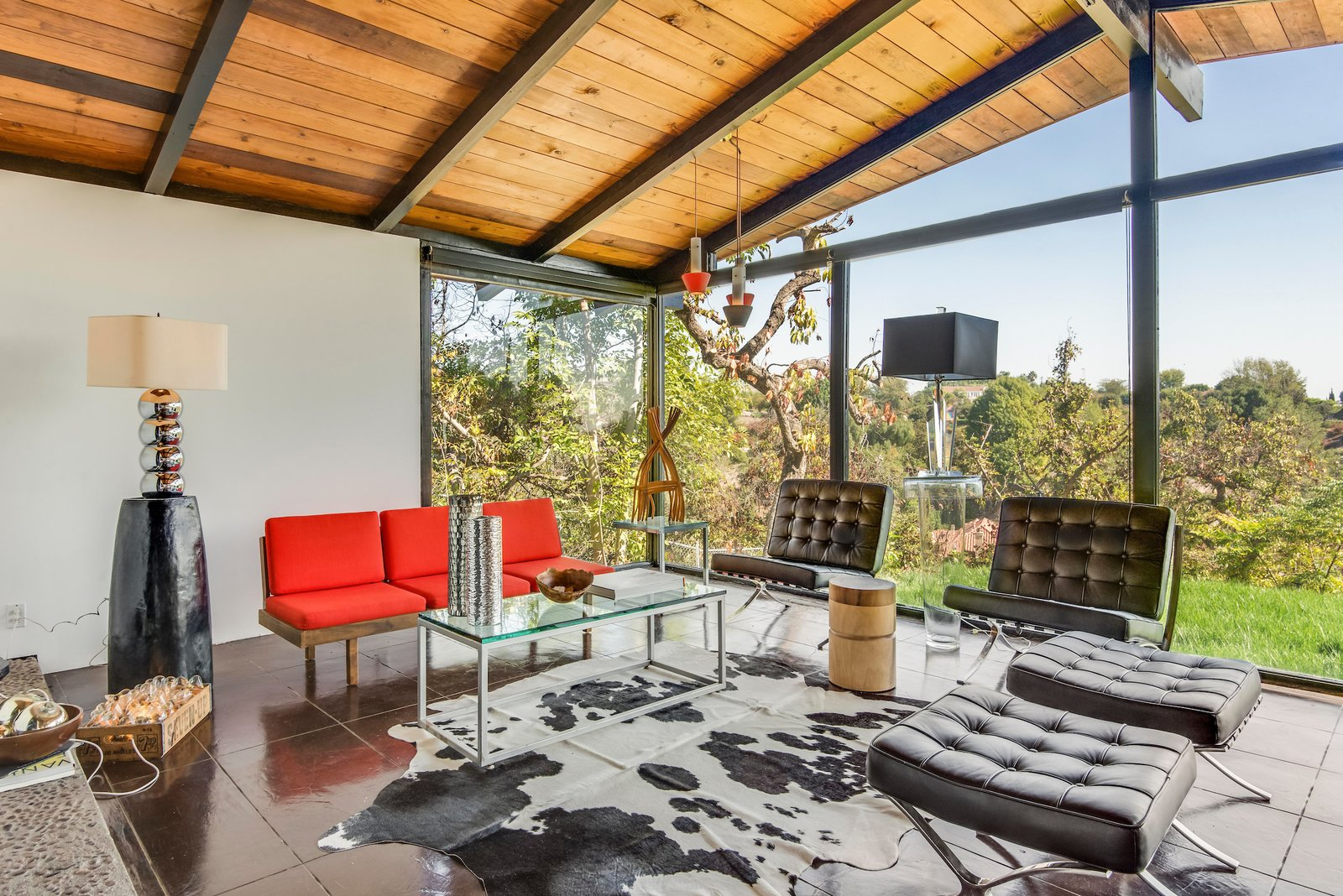 The vaulted, post-and-beam ceiling allows the living space to feel larger than it actually is.  Photo 5 of 10 in This Midcentury Home For Sale Is Not Your Regular Ranch House