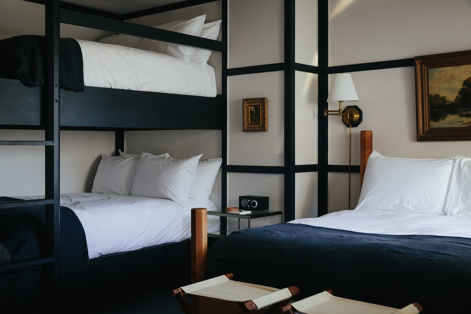 The beds are topped off with custom hand-dyed French linen blankets from Brooklyn-based Sharktooth. Additionally, each room is finished with high-gloss painted plywood floors that have a decorative wood trim running the edge of the room.  Photo 4 of 8 in Modern Equestrians Will Find Themselves at Home at This New Americana Hotel