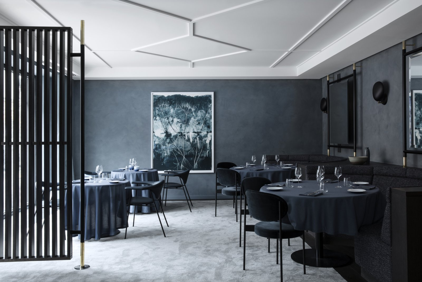 Unlike Flora Danica, Copenhague is draped in darker, more intense colors and textures. The walls are lined with GUBI's Cobra Lamps while the large-scale mirrors come from the same design concept as their TS Collection.
