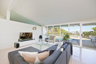"""If You Crave Bright, Light-Filled Spaces, This Midcentury Home For Sale Could Be the One - Photo 2 of 9 - Listing agent Elias Tebache points out that the most special element of the house is the abundance of light that streams in. """"Along with the high ceilings, its natural light creates such a warm feeling with great energy,"""" he says."""