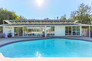 If You Crave Bright, Light-Filled Spaces, This Midcentury Home For Sale Could Be the One - Photo 9 of 9 - One of the past homeowners installed a large amount of solar panels on the roof of the house, which are fully paid off—so much that they actually generate more electricity than the house uses each month. The remaining funds don't go to waste, but are dropped into a city account that the next homeowner can pull from when desired.