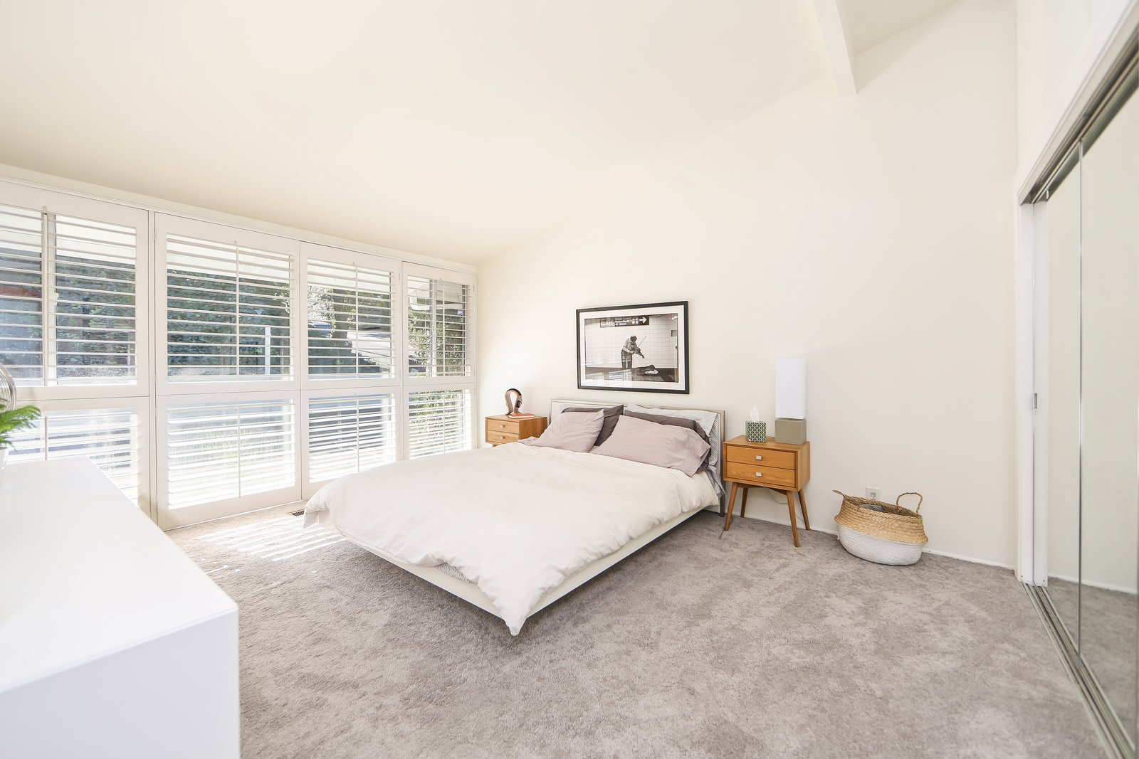 A past renovation included the addition of carpets into the three bedrooms, which have been left clean and simple. If You Crave Bright, Light-Filled Spaces, This Midcentury Home For Sale Could Be the One - Photo 8 of 10