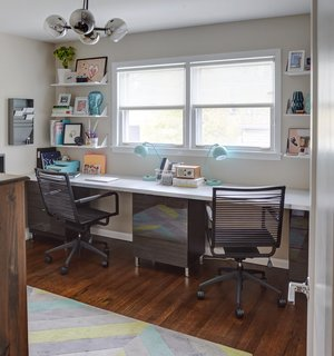 Clever Storage Solutions and a Shifted Layout Revive This 1950s Chicago Home - Photo 11 of 12 - Carly uses one of the bedrooms upstairs as her office, which is furnished with movable Ikea desk tops that fit the extent of the wall.