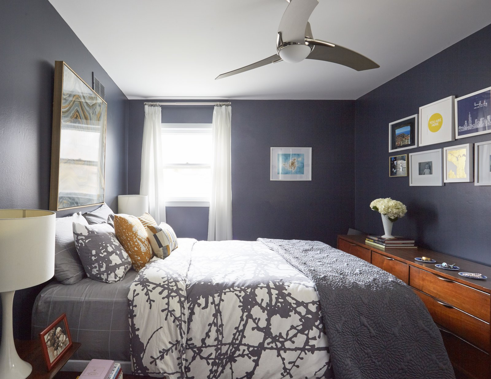 Though you cannot see in this photo, they added an extra closet in the bedroom to house Carly's vintage clothing collection. There are two other bedrooms on this upper floor.