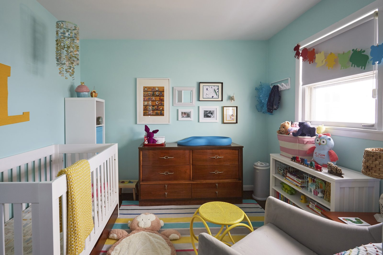 Like they thought may be in their future, they now share this home with their two-year-old daughter, whose room shares the upper floor with the master bedroom and the office.  Photo 12 of 12 in Clever Storage Solutions and a Shifted Layout Revive This 1950s Chicago Home