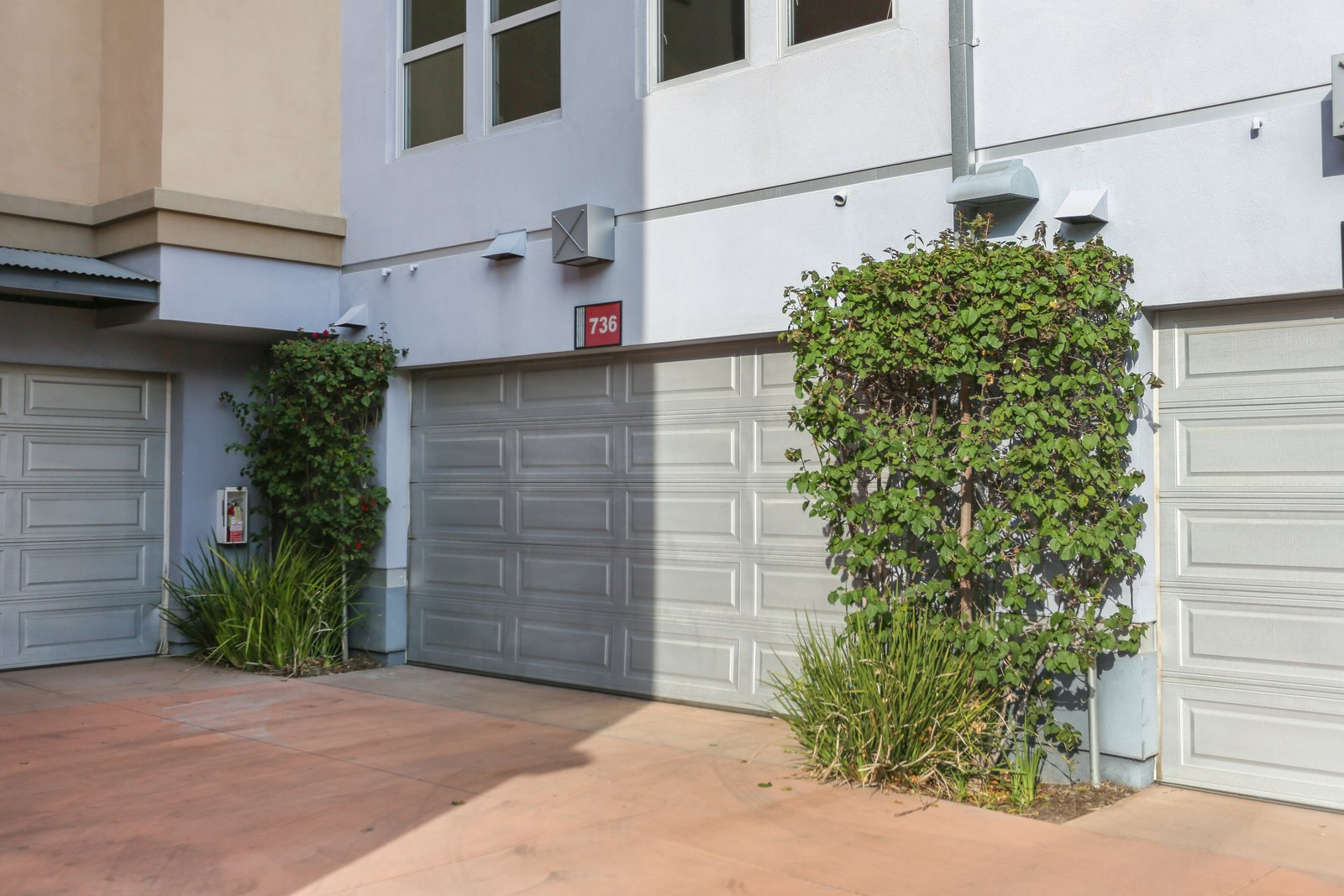 The steel-framed home sits behind an industrial roll-up door and has its own two-car garage in the back of the unit.  Photo 9 of 9 in A Designer Lists Her Three-Story Live/Work Loft in Orange County For $525K