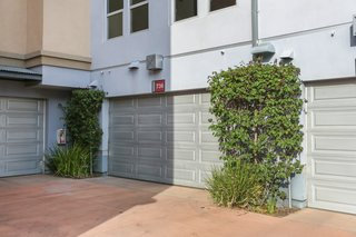 A Designer Lists Her Three-Story Live/Work Loft in Orange County For $525K - Photo 8 of 8 - The steel-framed home sits behind an industrial roll-up door and has its own two-car garage in the back of the unit.