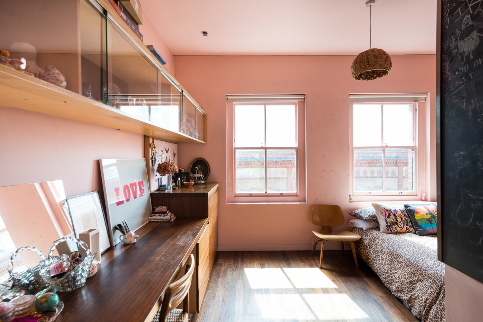 """On the second floor, you'll find two bedrooms, including a room that has a """"windowed cockpit,"""" which Brinkworth designed for the owners' children to look out over the garden."""