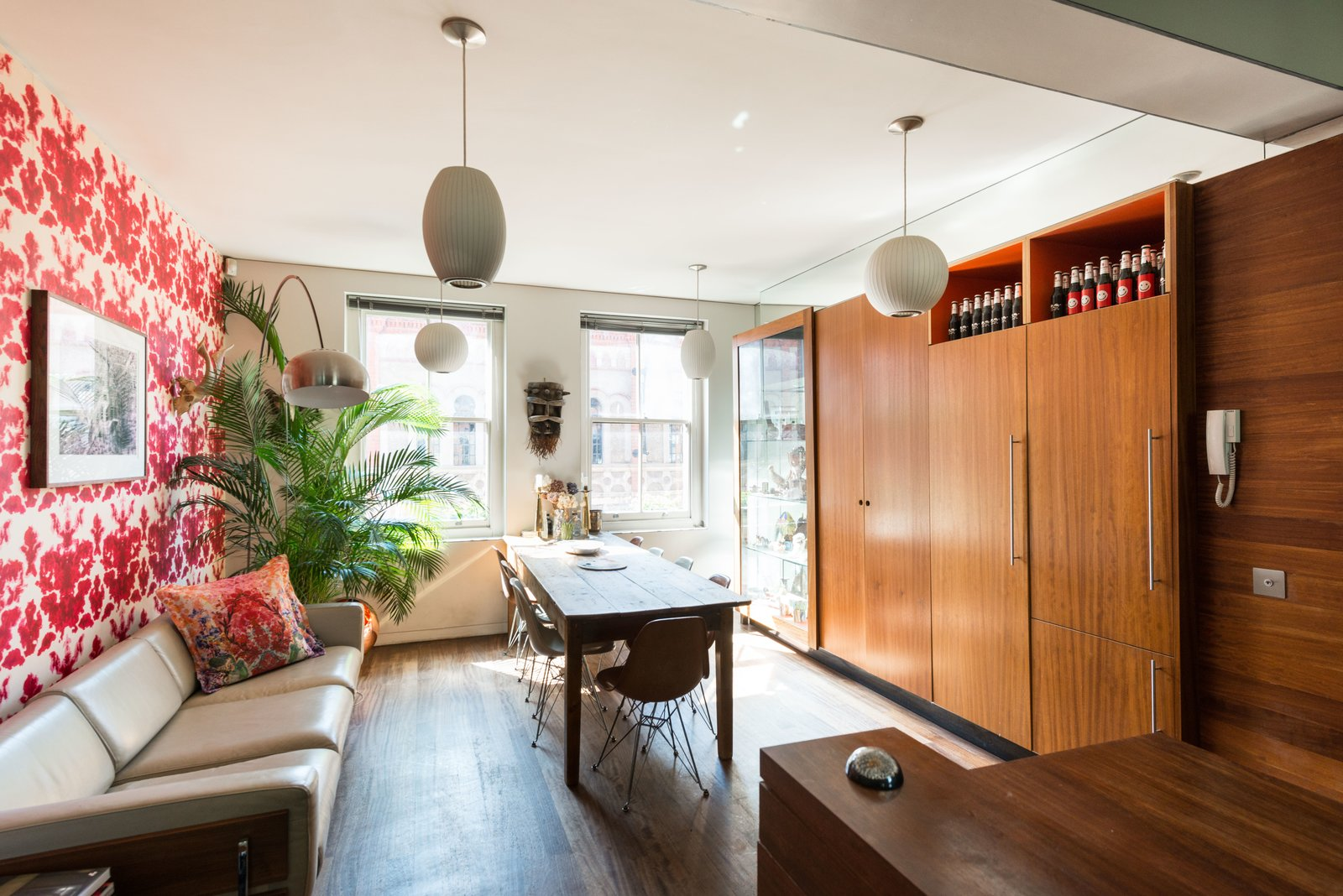 The dining space and kitchen are connected in a long, narrow section, and offer floor-to-ceiling cupboards.