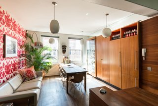 Formerly Home to an Artist and Knitwear Designer, a Commercial Space-Turned-Dwelling Hits the Market - Photo 3 of 10 - The dining space and kitchen are connected in a long, narrow space that's lined with floor-to-ceiling cabinets.