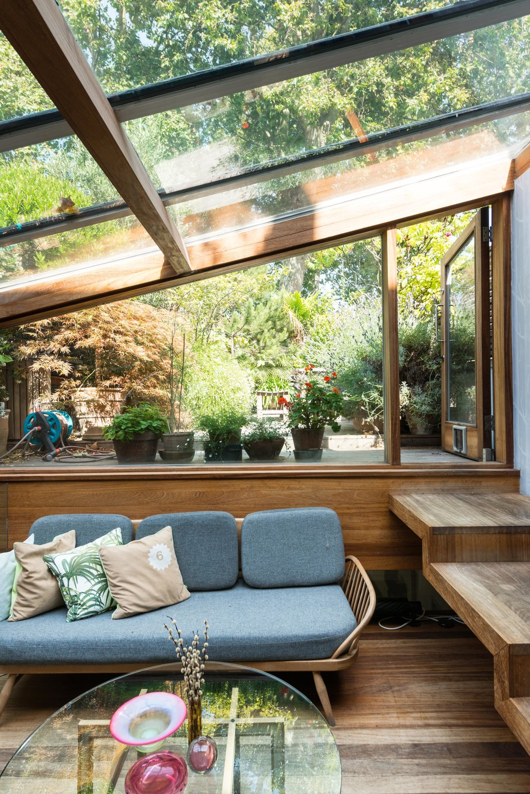 One of the additions that took place during Brinkworth's second phase of extensions, is the glazed garden room, which sits half a level below the first floor. Handcrafted wooden steps lead you to a terraced garden.