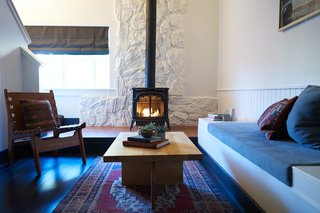 A Modern Mountain Lodge That Will Make You Love Winter Like Never Before - Photo 6 of 13 - In order to preserve the structural quirks throughout the property, many rooms boast high-peaked ceilings, lofted areas, and sleeping spaces. Many rooms also have their own fireplace or cast-iron stove.