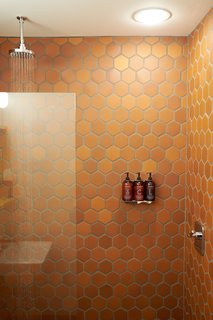 A Modern Mountain Lodge That Will Make You Love Winter Like Never Before - Photo 5 of 13 - Each room's bathroom is equipped with showers lined with Terracotta tile, modern rain showers, and skin and haircare products made exclusively for Scribner's.
