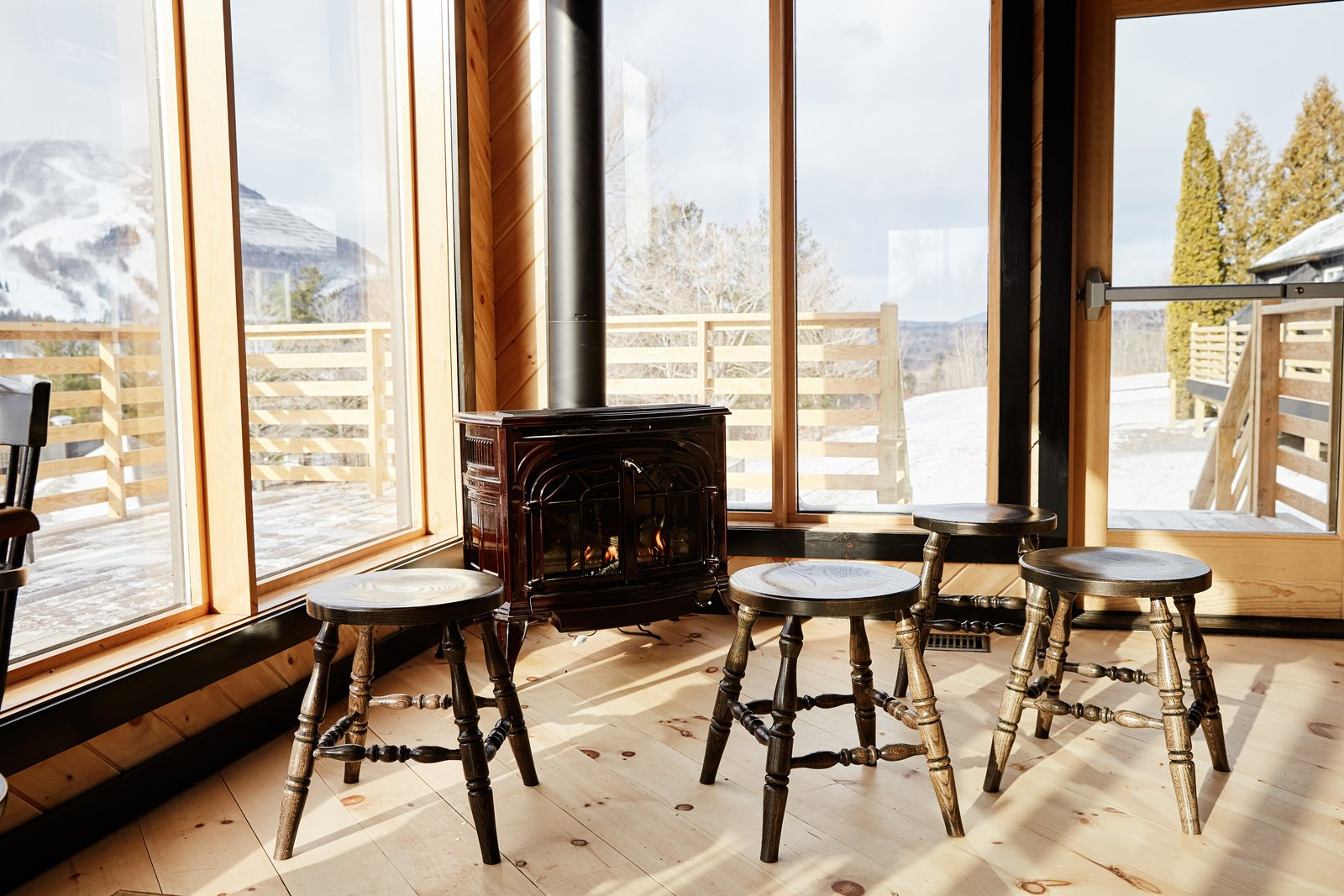 The restaurant looks out to 270-degree views of the Catskill Mountains and takes in ample natural light.  Photo 11 of 14 in A Modern Mountain Lodge That Will Make You Love Winter Like Never Before