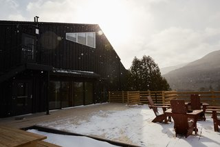 A communal fire pit on the wrapped patio offers a space to relax outdoors while being fully immersed in the mountains.