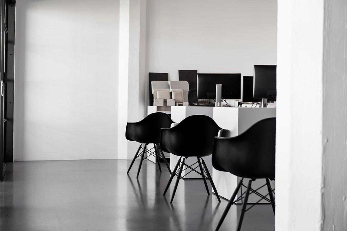The space is also filled with Herman Miller's all-black edition of the Eames Molded Fiberglass Armchair.  Photo 13 of 13 in A San Francisco Design Collective Reveals its Impeccably Cool Creative Studio