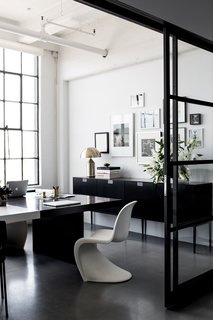 A San Francisco Design Collective Reveals its Impeccably Cool Creative Studio - Photo 6 of 12 - Hollis shares this office with her husband and CEO, Lewis Heathcote. Panton Chairs, designed by Verner Panton for Vitra, can be found in various areas of the office. Poured concrete floors are kept consistent throughout the space.