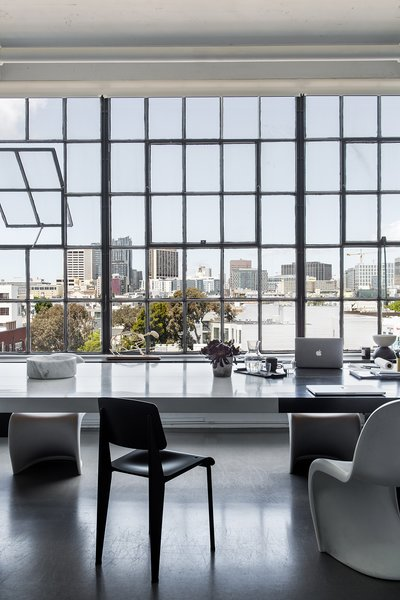 Hollis' team opened the space by removing multiple walls and preserving the original steel windows and high ceilings. The views stretch from the Bay Bridge to Twin Peaks.