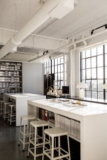 A San Francisco Design Collective Reveals its Impeccably Cool Creative Studio - Photo 9 of 12 - Hollis made sure to create areas where vendors, artists, and artisans can drop off their work or samples. Shown here is the materials library and high-top tables that provide storage and allow for casual, impromptu meetings.