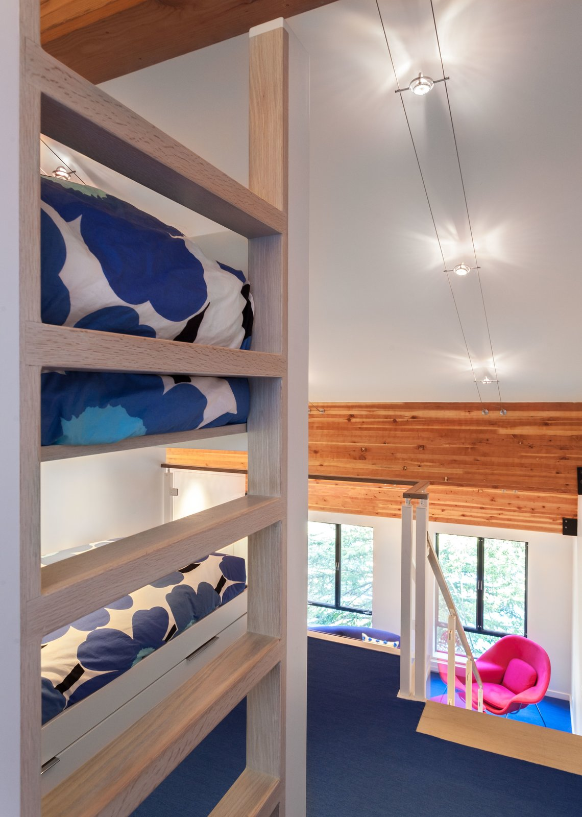 The original loft had only one bedroom upstairs, but Simon was able to turn it into two bedrooms. She installed a custom built-in bunk bed.  Photo 6 of 10 in Bright Colors and Sleek White Oak Fill This Playful Lake Tahoe Loft