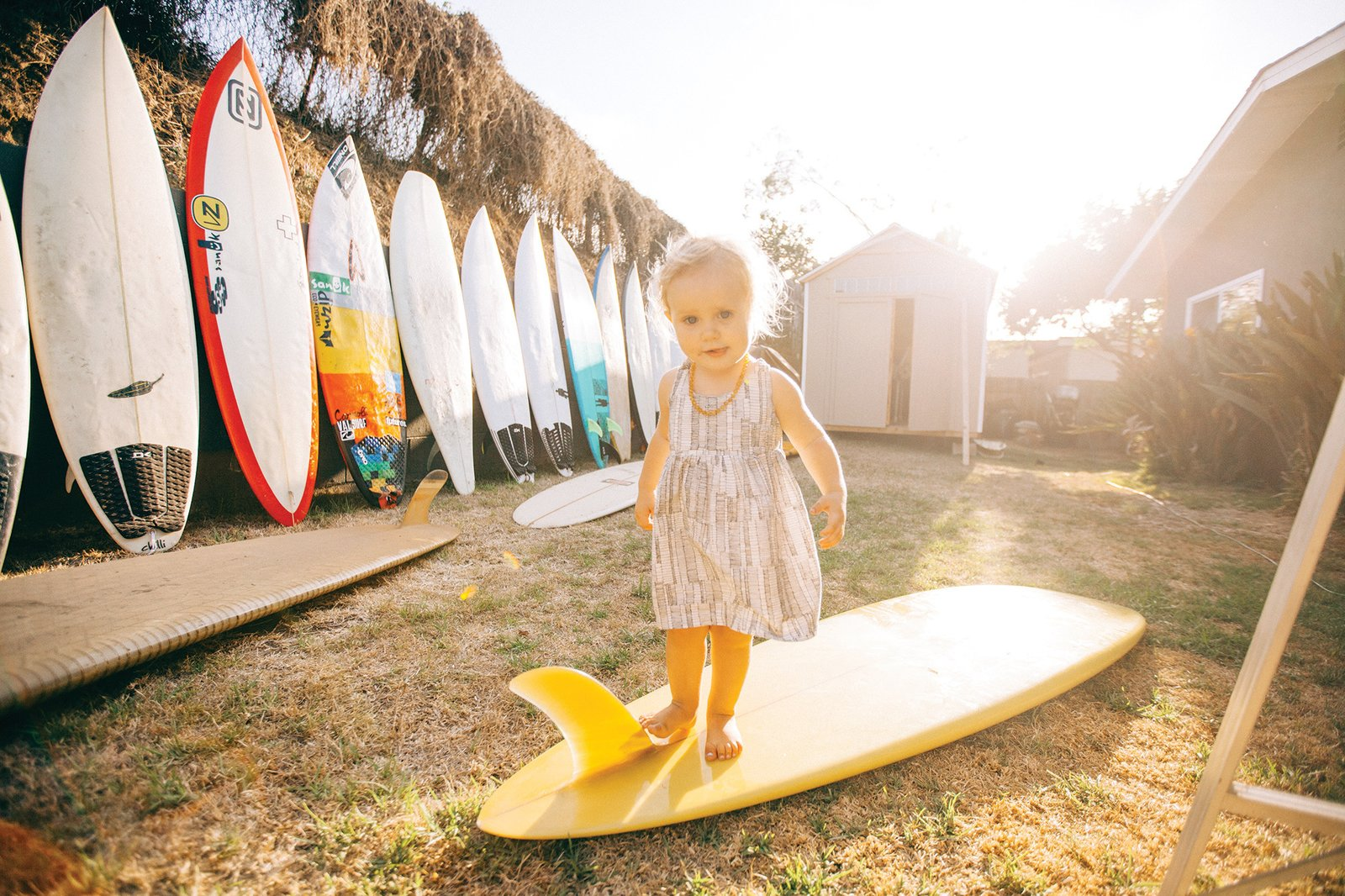 Grant Ellis has been the photo editor at Surfer Magazine for 13 years and lives in a quaint beach shack in Cardiff, California with his wife Julie, son Ethan, and daughter Kaia (shown here).  Photo 5 of 11 in Indoek's New Book Shares a Glimpse Into the Homes of Creative Surfers