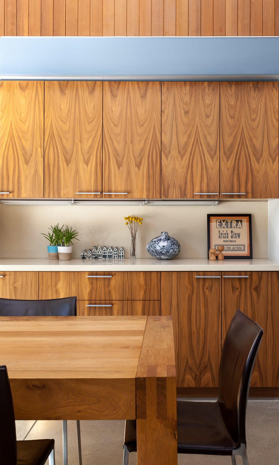 They installed walnut cabinetry and vertical boards made of clear western cedar with a simple oil finish.  Photo 7 of 11 in A Year of Careful Study Leads to a Thoughtful Renovation of a 1949 Eichler