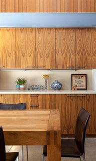 A Year of Careful Study Leads to a Thoughtful Renovation of a 1949 Eichler - Photo 6 of 10 - Throughout the interior, they installed walnut cabinetry and vertical boards made of clear western cedar with a simple oil finish.