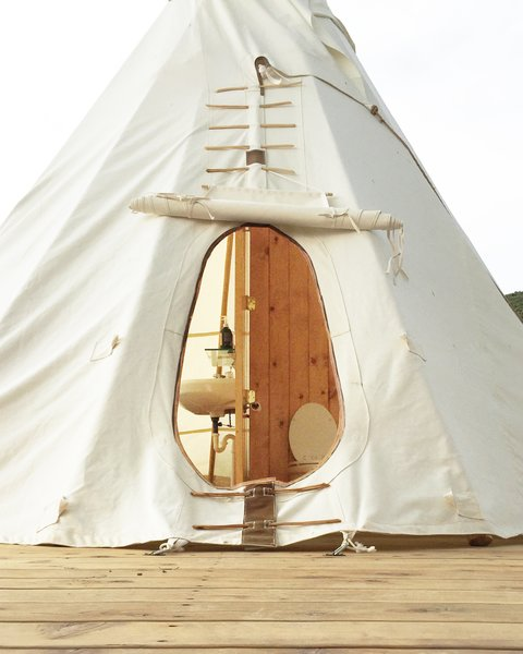 Each tent is connected to its own teepee bathroom that has everything you need including a shower, sink, toilet, Turkish towels, and storage.