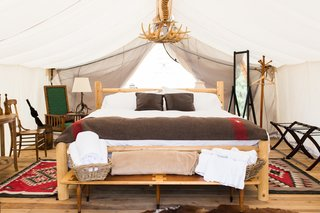 Get the Modern Camping Experience You Crave at One of These New Secluded Retreats - Photo 3 of 11 - At the Vail location, designer Cassie Novick sourced western, ranch-inspired furnishings from local markets, estate sales, and flea markets. In the tents, you'll find Native American-inspired details, special books, and maybe even some vintage board games.