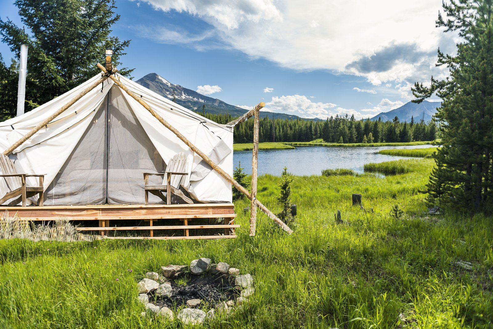 The team behind Collective Retreats built the custom canvas tents with wood that they sourced locally. They used timber they found in the property's vicinity to hold the peaks together at the top. Shown here is the Yellowstone location. Tagged: Exterior and Tent Building Type.  Photo 3 of 12 in Get the Modern Camping Experience You Crave at One of These New Secluded Retreats
