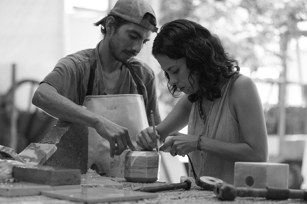Caterina Moretti, Peca's head designer and studio director, is shown here working closely with a marble object.  Photo 9 of 16 in Caravana Americana Showcases the Passion of Latin America's Design Community