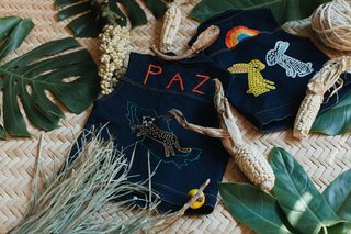 Part II of Our Exploration of Mexico City's Caravana Americana - Photo 9 of 18 - They produce little denim vests for kids that are handmade with a traditional embroidery process in Zinacantán in Chiapas, México.