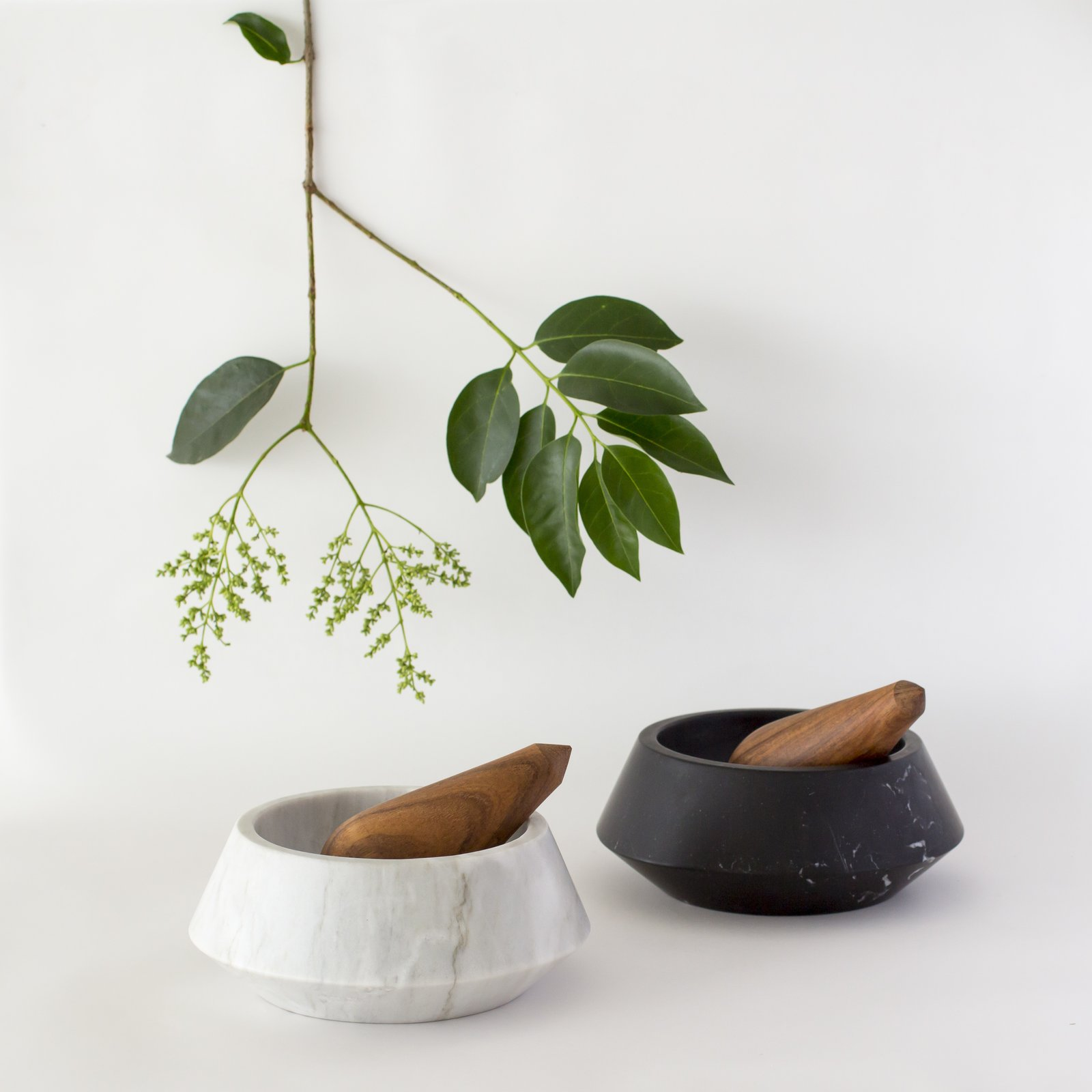 The mortar of their pestle and mortar is made with two types of marble while the pestle is handmade out of Guayacan wood that's sourced from the Yucatán and is finished with palm wax and linseed oil.
