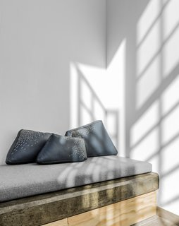 Designed by Caterina Moretti and Justine Trouéau, the leather Pita Cushions feature embroidery that's created with pita, a fiber that comes from the leaves of the Agave Americana plant—also known as American aloe, century plant, or maguey. Using this Colotlán technique, they've created a design that depicts rain falling on a mountain.