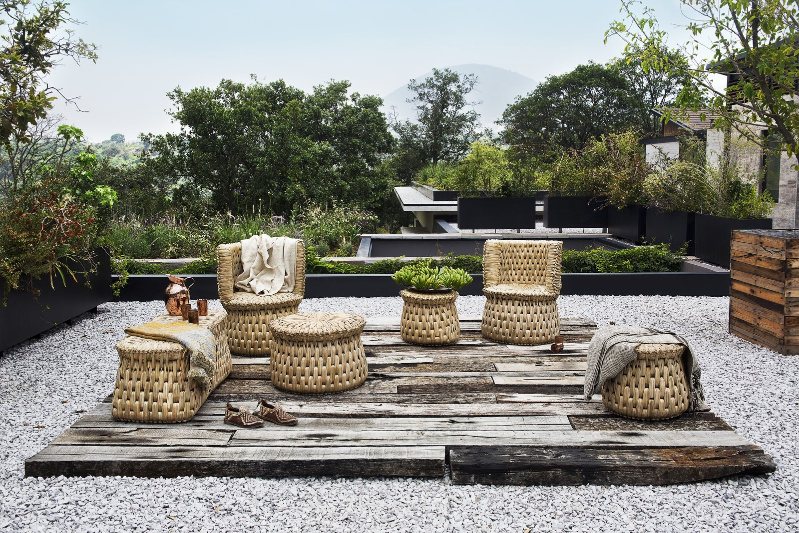 "txt.ture's first collection is made in alliance with master artisan Don Nacho Morales, and includes six furniture pieces that are inspired by functional seating pieces used throughout Aztec history. Shown here is the tabouret, individual armchair, and wooden core bench—all made with locally-sourced seagrass, or ""tyle."