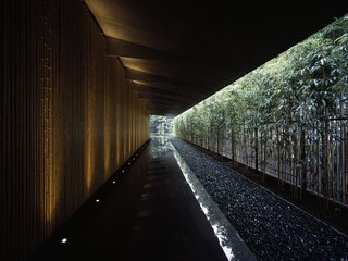 Surrounded by a garden and featuring a bamboo lined approach, the Nezu Museum's unique roof design blends the interior space with the garden.