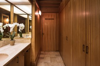 The Midcentury Home That Daniel Liebermann Built For His Parents Asks $2.8 Million - Photo 8 of 16 - The only full privacy that exists in the main house—since everything is surrounded by glass—is in a cube that Jay placed in the center of the house. It's seven feet tall, covered with a thin sheet of fiberglass to let the light stream in from a skylight, and holds two-and-a-half bathrooms. The woodworking here is done with a mahogany finish.