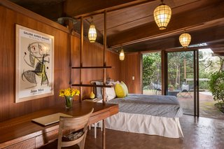 The Midcentury Home That Daniel Liebermann Built For His Parents Asks $2.8 Million - Photo 9 of 16 - The guest bedroom in the main house holds a built-in desk that was installed by Jay's father, who took inspiration from the lines and shapes of the rest of the house.