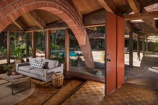 The Midcentury Home That Daniel Liebermann Built For His Parents Asks $2.8 Million - Photo 2 of 16 - The original red front door leads directly into the living room, which has oak parquet flooring and a radiant heating system throughout that still works to this day.