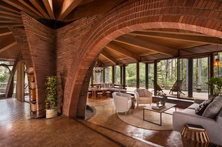 The Midcentury Home That Daniel Liebermann Built For His Parents Asks $2.8 Million - Photo 3 of 16 - Liebermann and his wife Eva did the brickwork in the house—the most impressive section being the two arches that hover over the living areas and are surrounded by the home's old-growth redwood structure.