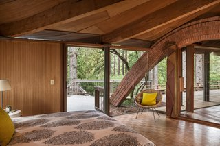 The Midcentury Home That Daniel Liebermann Built For His Parents Asks $2.8 Million - Photo 7 of 16 - One of the brick arches connects to the master bedroom, which has an accordion door installed by Jay's father that can shut off one side of the room from the rest of the living space.