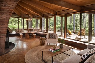 The Midcentury Home That Daniel Liebermann Built For His Parents Asks $2.8 Million - Photo 6 of 16 - In the corner of the living room sits a round table that the Little family brought from Minnesota. Jay's father made the rounded stools out of garbage cans from Cost Plus, and built the custom corner seat to create a comfortable nook.
