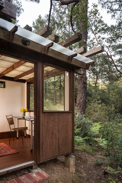 Jay and his father built a tiny office with red Dutch doors under the deck where they could escape from the constant action that occurs when you live with a large family.