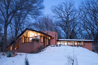 The Original Homeowners of a Frank Lloyd Wright-Designed House Ask $1.4 Million - Photo 7 of 7 - Like most of Wright's designs, the house is completely integrated into the landscape and was designed to bring the outside in.