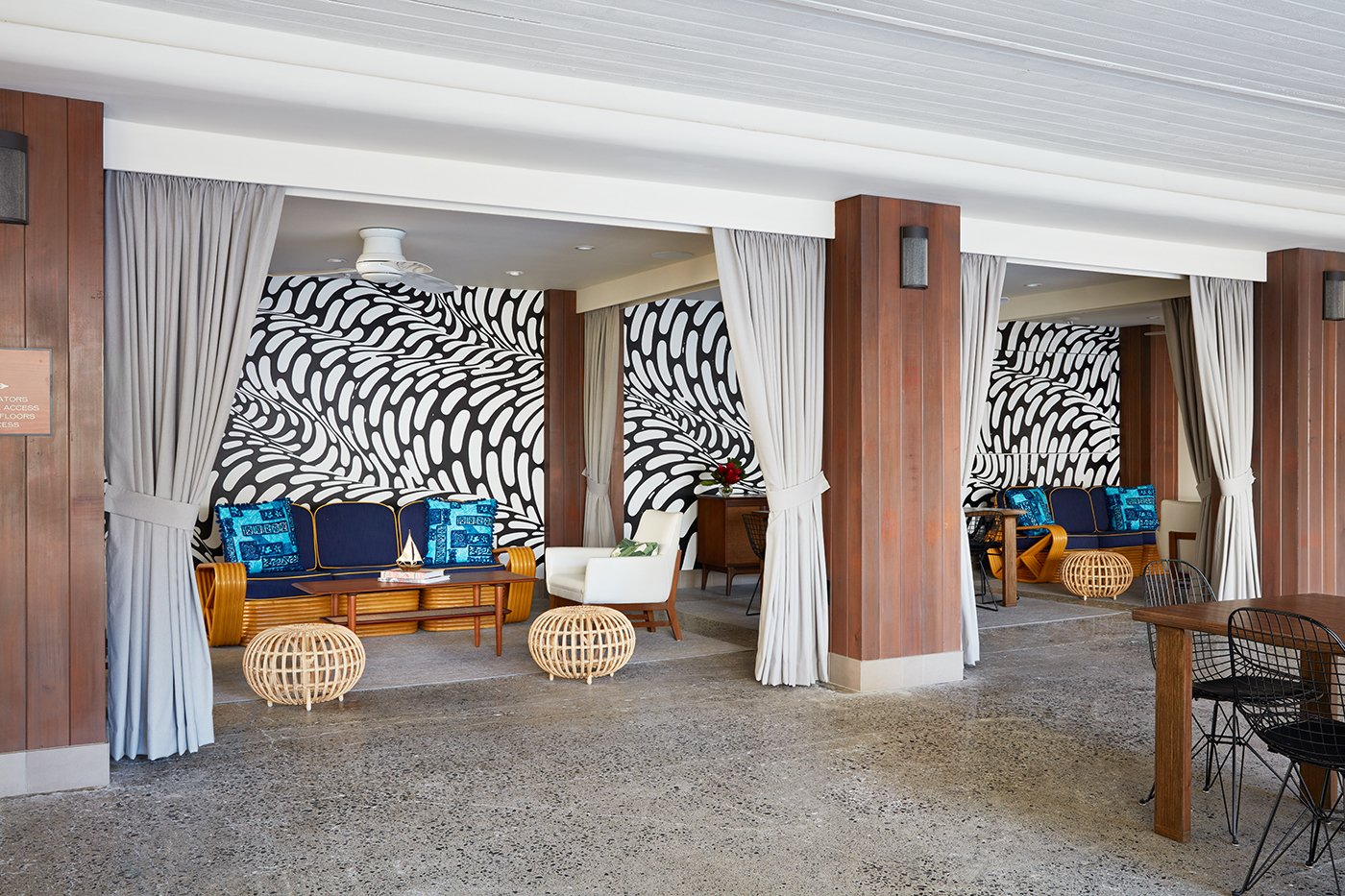 "In addition to the space being filled with furnishings, lighting, and artwork by a range of local designers, every little detail was thoroughly thought out and branded to fit seamlessly with the Surfjack ethos. Shown here is the hand-painted mural by Brendan ""The Blog"" Monroe.  Photo 1 of 14 in This Surf-Inspired Hotel Celebrates Waikiki's Creative Spirit and its Midcentury Roots"