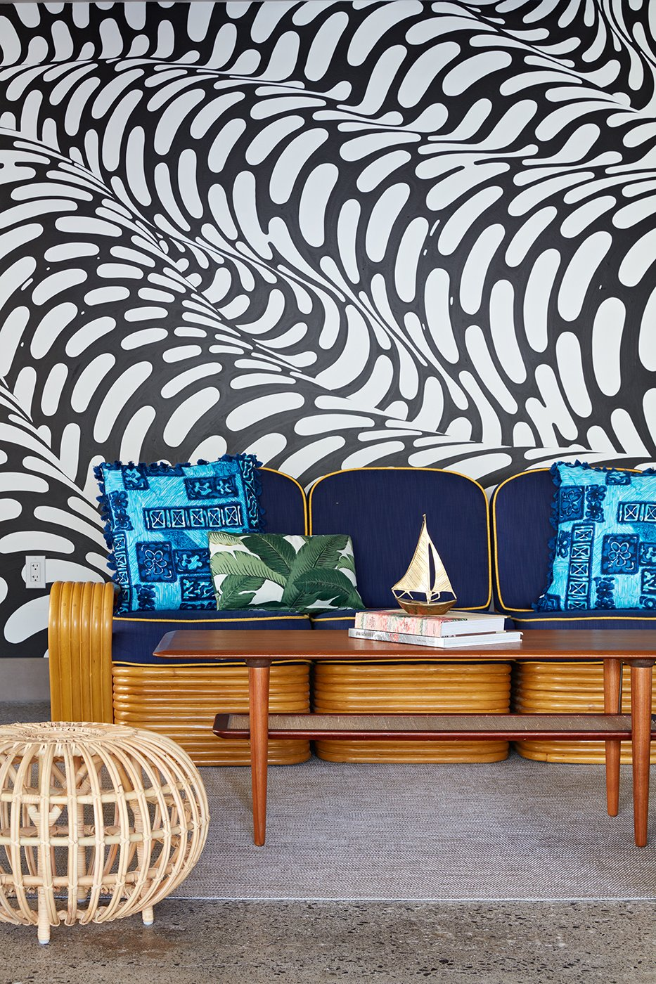 "In the covered cabana area by the pool, a hand-painted mural by Brendan ""The Blob"" Monroe creates a funky backdrop that's inspired by the flow of water. Local artist, illustrator, and curator Jasper Wong co-curated the mural artwork found throughout the property.  Photo 4 of 14 in This Surf-Inspired Hotel Celebrates Waikiki's Creative Spirit and its Midcentury Roots"