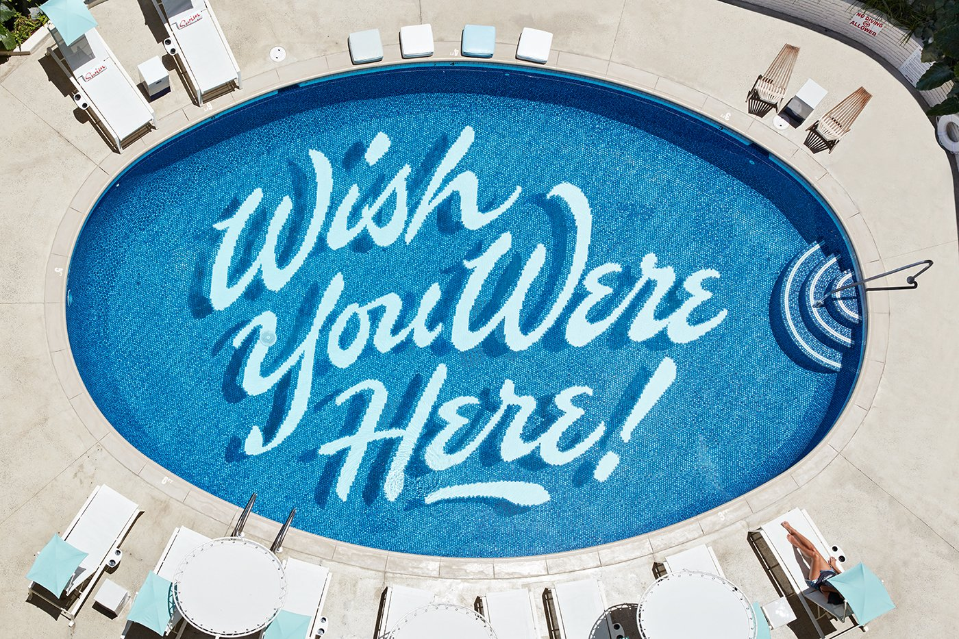 Self-taught graphic artist Matthew Tapia hand-painted the illustrated text on the bottom of the pool.  Photo 5 of 14 in This Surf-Inspired Hotel Celebrates Waikiki's Creative Spirit and its Midcentury Roots