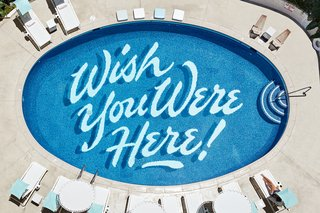 7 Community-Focused Maker Hotels Around the World - Photo 4 of 9 - Self-taught graphic artist Matthew Tapia hand-painted the illustrated text on the bottom of the pool.