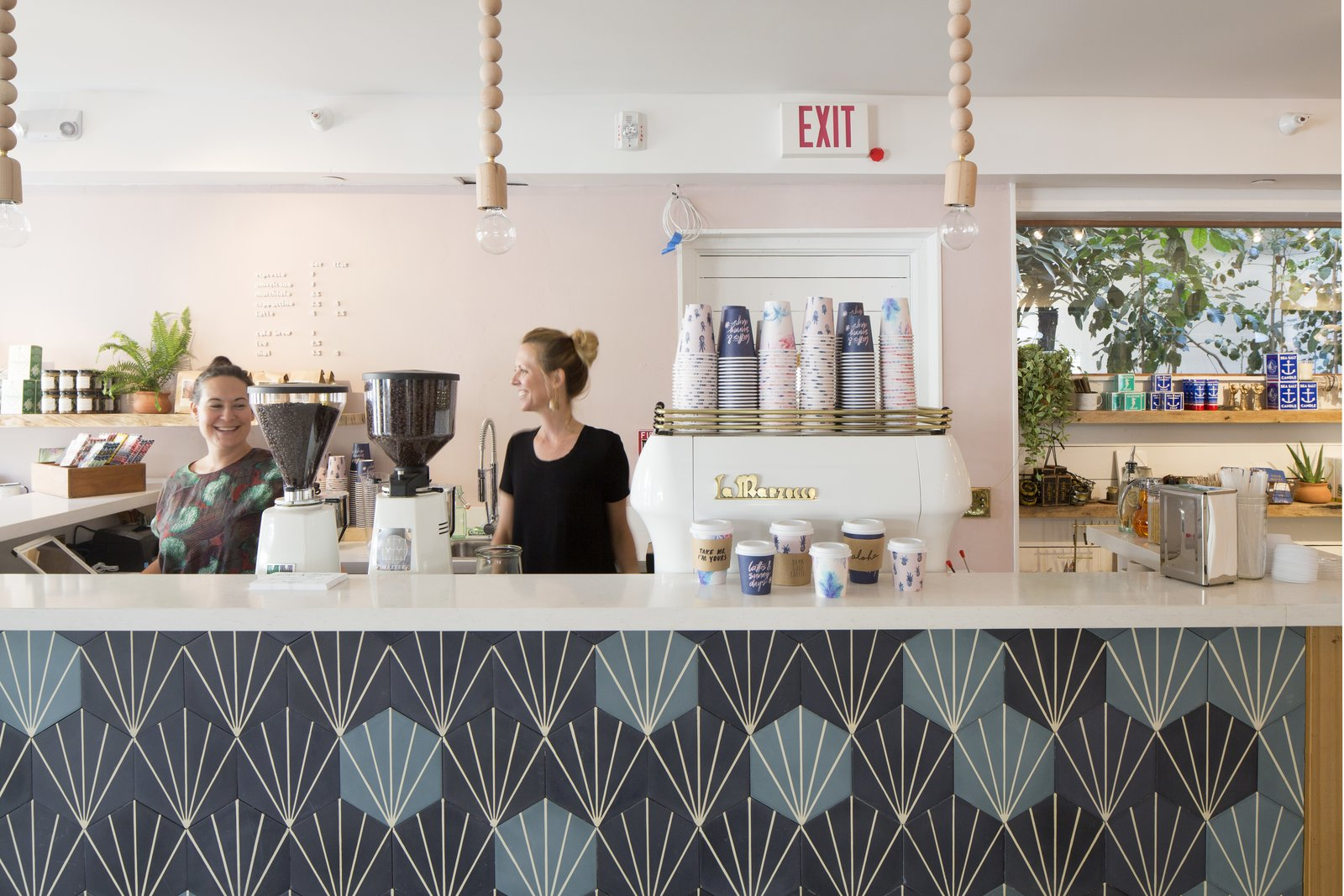 Immediately when you walk in, Olive & Oliver catches your eye on the left. Founded by husband-and-wife team, Ali McMahon and Parker Moosman, the boutique that accompanies the coffee shop boasts a curated collection of fashion and home goods that are inspired by iconic surf culture. This Surf-Inspired Hotel Celebrates Waikiki's Creative Spirit and its Midcentury Roots - Photo 10 of 14