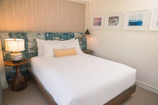 The bedrooms are graced with headboards that Studio Collective created with vintage Tori Richard prints. The dreamy framed surf photography on the wall is by She Hit Pause Studios.